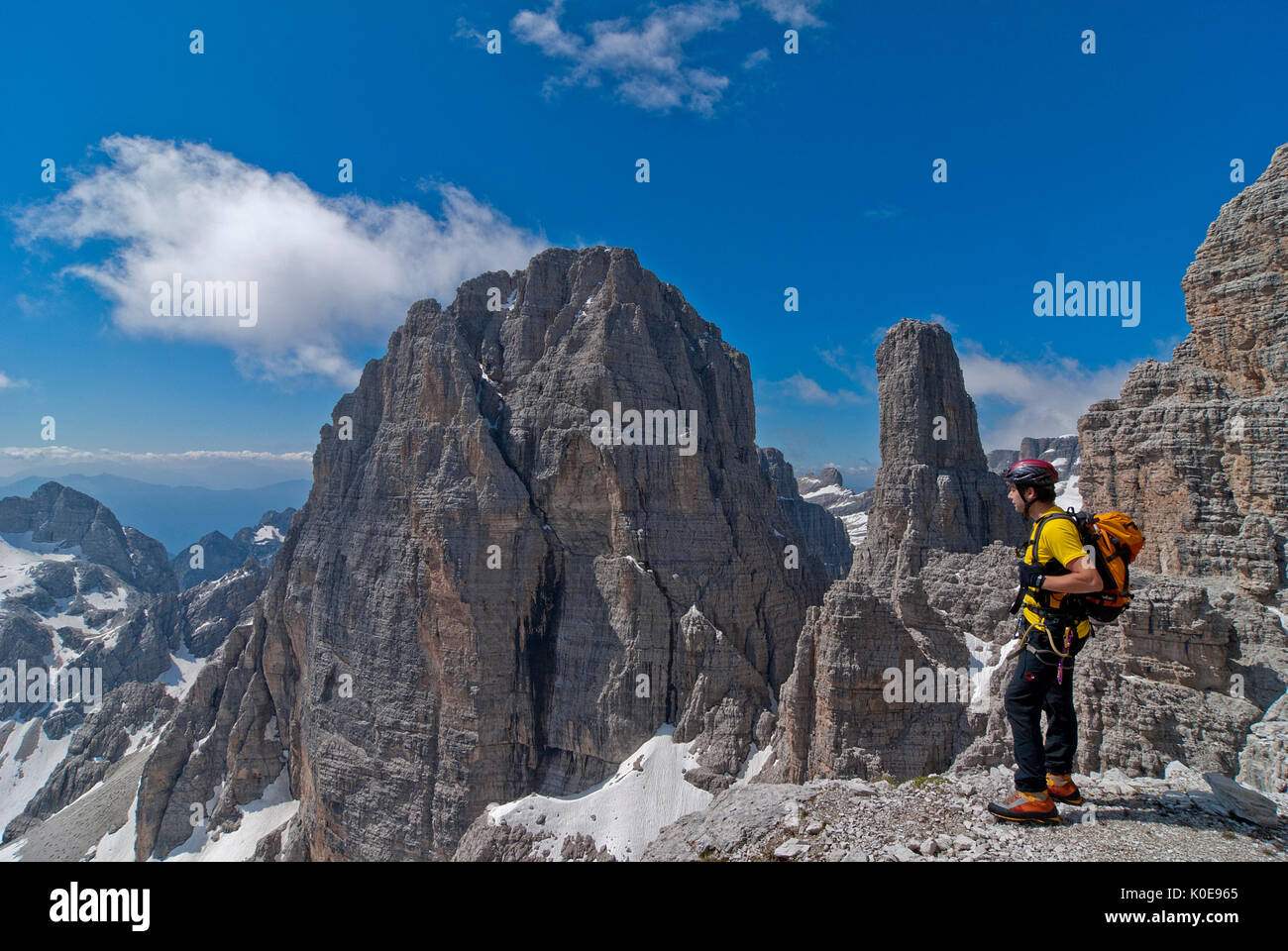 Brenta, Trentino, Italy. Climber on the via ferrata 'Sentiero delle Bocchette Centrali'. In the background the Cima Brenta Alta and the famous Campani - Stock Image