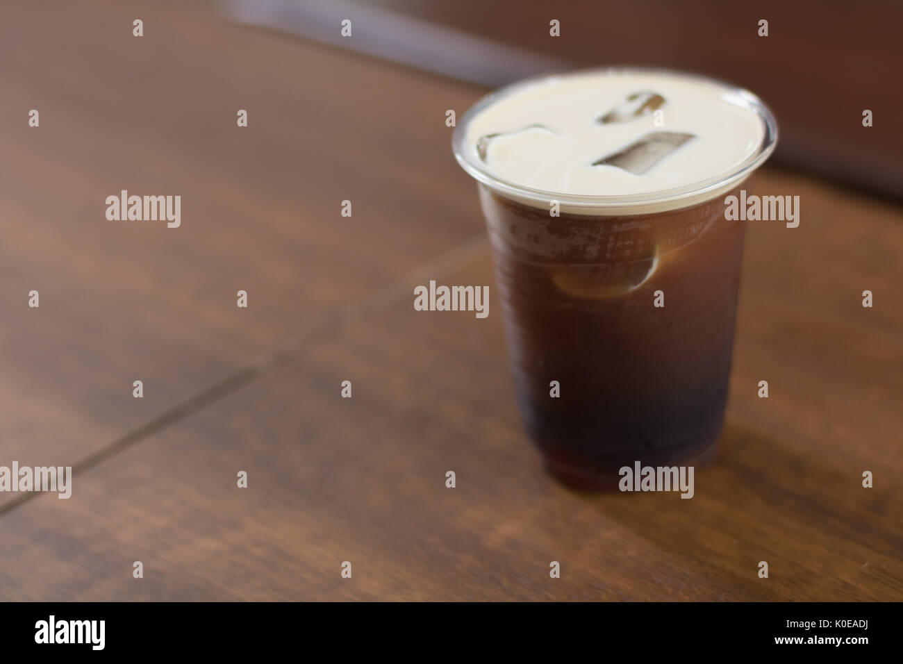 Sparkling Nitro Cold Brew Coffee in plastic take away cup ready to drink - Stock Image