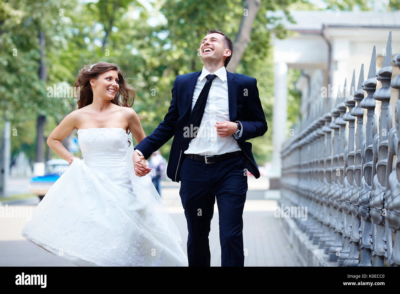 Strange Happy Bride And Groom Running Laugh Laughing On Wedding Day Download Free Architecture Designs Scobabritishbridgeorg