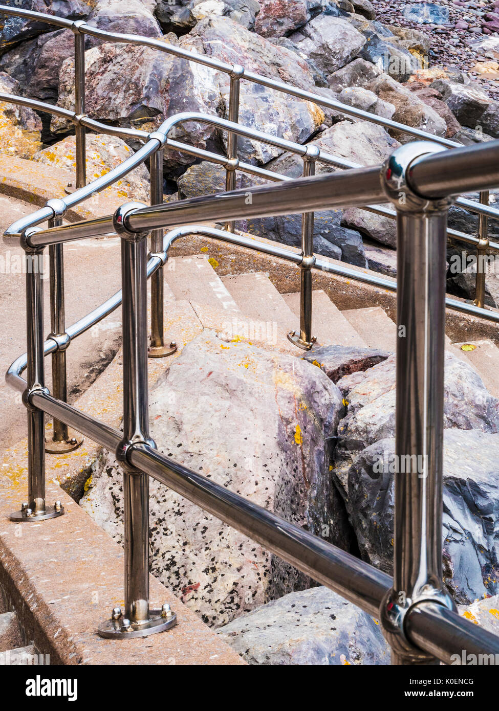 An abstract pattern picture of the railings and steps leading to the beach at Minehead in Somerset. - Stock Image