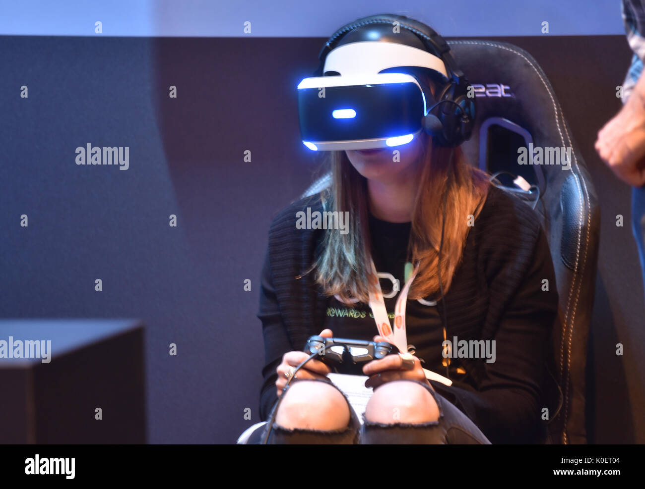 Cologne, Germany. 22nd Aug, 2017. Germany, Cologne, August 22, 2017, Gamescom: A young woman wears virtual reality glasses. Credit: Juergen Schwarz/Alamy Live News Stock Photo