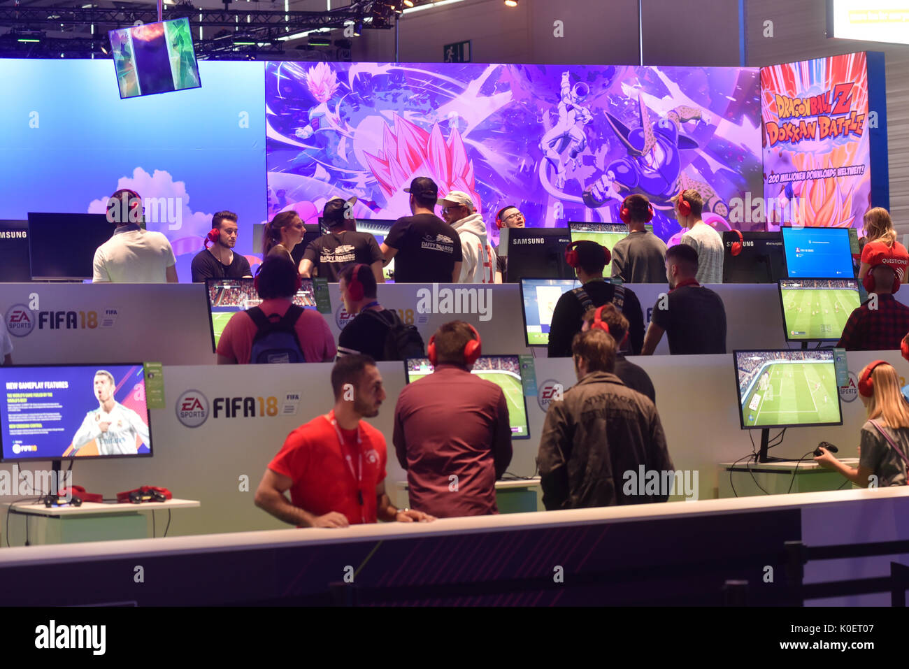 Cologne, Germany. 22nd Aug, 2017. Germany, Cologne, August 22, 2017, Gamescom: Players at the booth of EA Sports mit FIFA 18. Credit: Juergen Schwarz/Alamy Live News - Stock Image