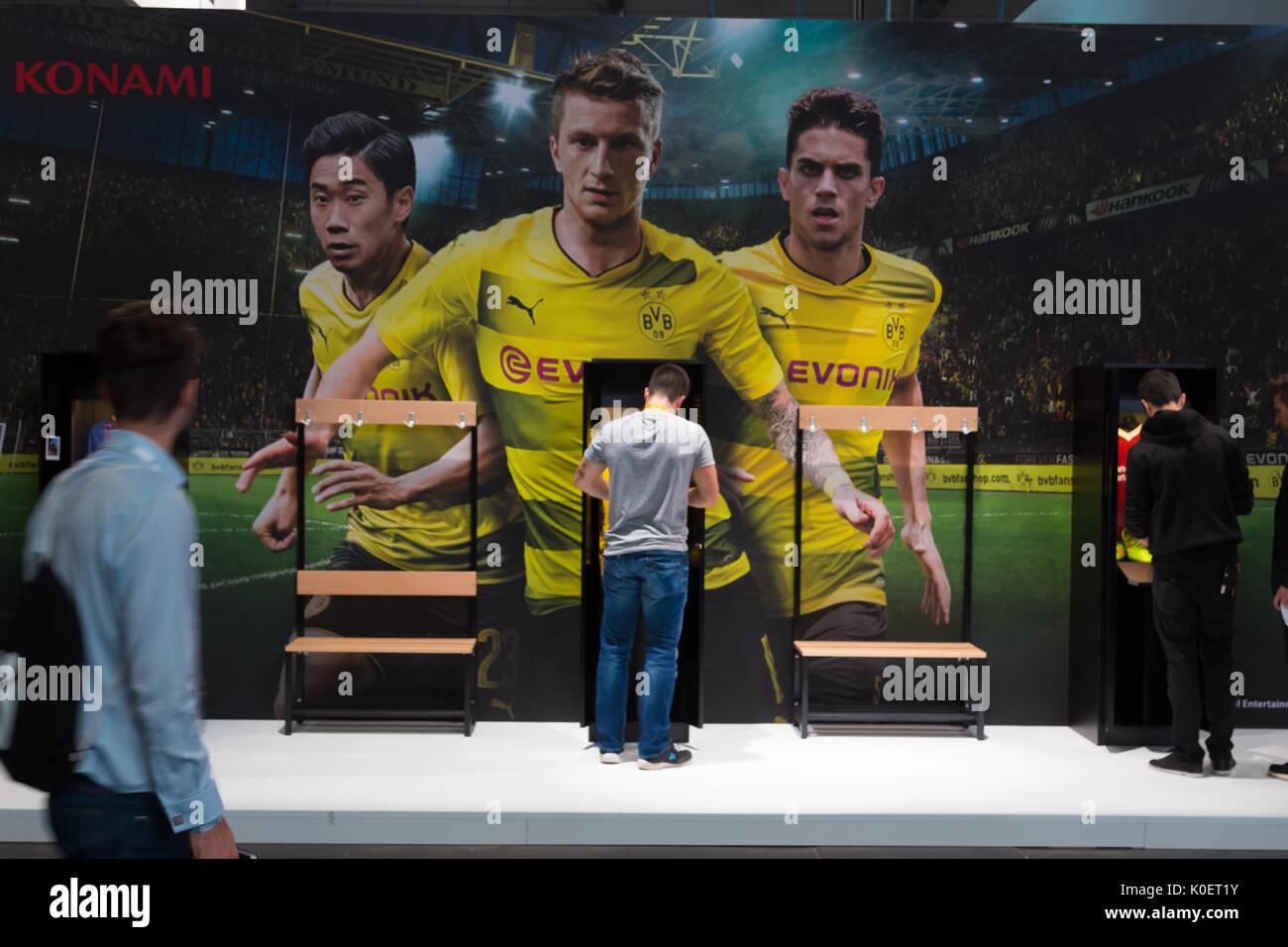 Cologne, Germany. 22nd Aug, 2017. Germany, Cologne, August 22, 2017, Gamescom: Booth of Borussia Dortmund BVB Edition of Konami. Credit: Juergen Schwarz/Alamy Live News - Stock Image