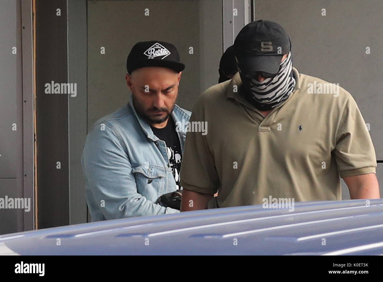 Moscow, Russia. 22nd Aug, 2017. Theatre and film director Kirill Serebrennikov (L) leaves the Russian Investigative Committee building. On August 22, 2017, Serebrennikov was detained on fraud charges. He is accused of embezzling 68 million roubles ($1.1 million) of state funding allocated for the Platforma theatre project between 2011 and 2014. Credit: Vyacheslav Prokofyev/TASS/Alamy Live News - Stock Image