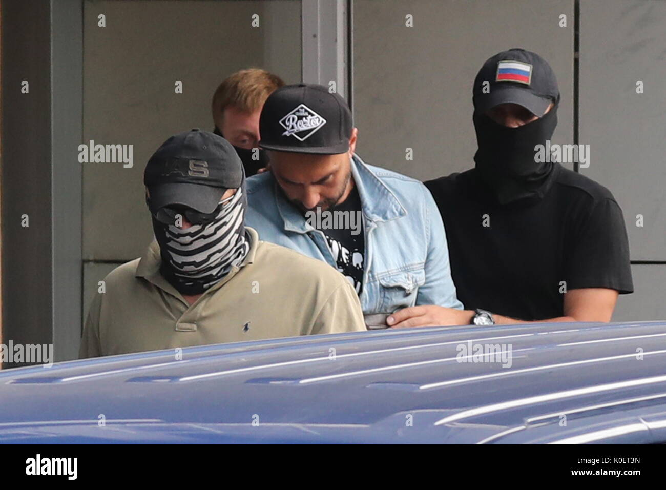 Moscow, Russia. 22nd Aug, 2017. Theatre and film director Kirill Serebrennikov (C) leaves the Russian Investigative Committee building. On August 22, 2017, Serebrennikov was detained on fraud charges. He is accused of embezzling 68 million roubles ($1.1 million) of state funding allocated for the Platforma theatre project between 2011 and 2014. Credit: Vyacheslav Prokofyev/TASS/Alamy Live News - Stock Image