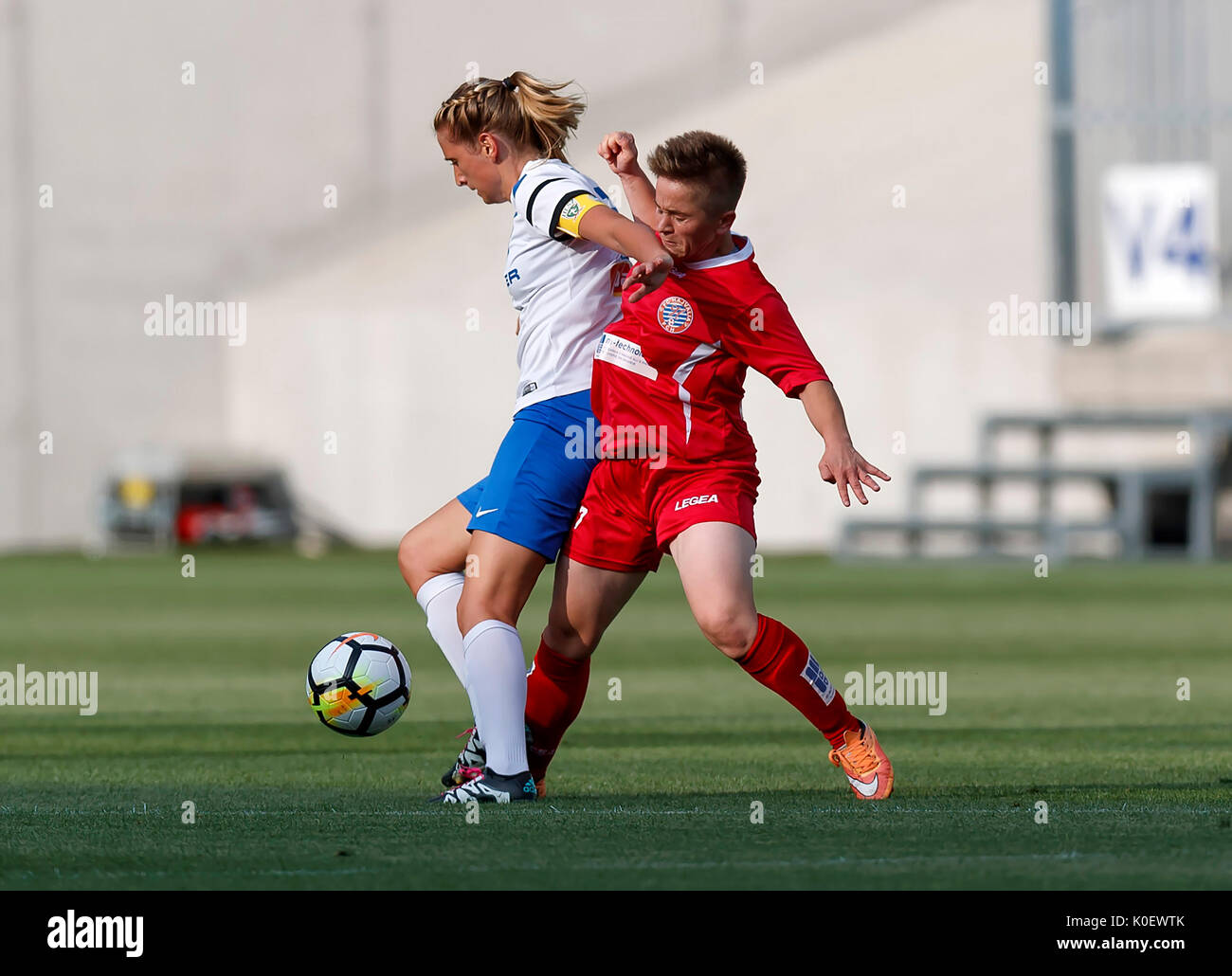 BUDAPEST, HUNGARY - AUGUST 22: Anita Pinczi (L) of MTK Hungaria FC competes for the ball with Qendresa Bajra (R) of WFC Hajvalia during the UEFA Women's Champions League Qualifying match between MTK Hungaria FC and WFC Hajvalia at Nandor Hidegkuti Stadium on August 22, 2017 in Budapest, Hungary. - Stock Image