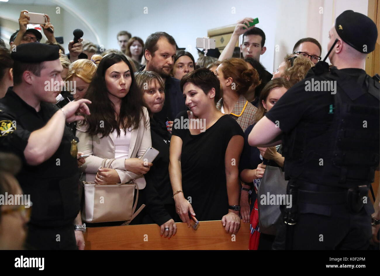 Moscow, Russia. 23rd Aug, 2017. Journalist wait for theatre and film director Kirill Serebrennikov in Moscow's Basmanny District Court. On August 22, 2017, Serebrennikov was detained on fraud charges. He is accused of embezzling 68 million roubles ($1.1 million) of state funding allocated for the Platforma theatre project between 2011 and 2014. Stanislav Krasilnikov/TASS - Stock Image