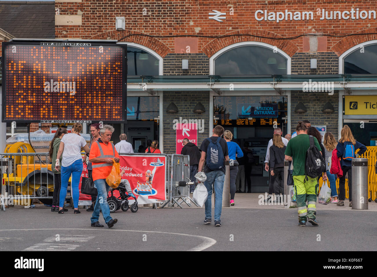 London, UK. 23rd August, 2017. Staff and signs warn passengers of a 75% reduction in service going through Clapham Stock Photo