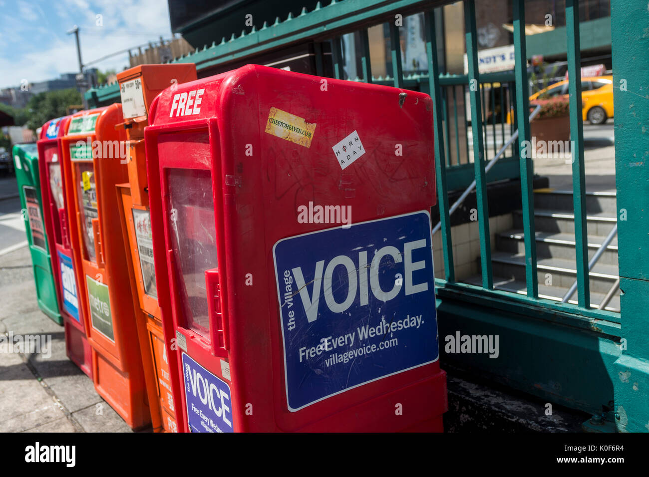 New York, NY, USA. 23rd Aug, 2017. Newspaper boxes outside the subway station in Sheridan Square, across the street from 61 Christopher Street, where the Village Voice opened it's first office in the early 60s. On Tuesday August 22, Peter D Barbey announced the 62 year old alternative weekly newspaper would no longer publish a print edition.An online edition will still be available via the internet CREDIT: Credit: Stacy Walsh Rosenstock/Alamy Live News - Stock Image