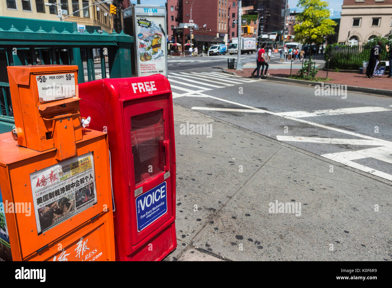 New York, NY, USA. 23rd Aug, 2017. Newspaper boxes in Sheridan Square, across the street from 61 Christopher Street, where the Village Voice opened it's first office in the early 60s. On Tuesday August 22, Peter D Barbey announced the 62 year old alternative weekly newspaper would no longer publish a print editionAn online edition will still be available via the internet CREDIT: Credit: Stacy Walsh Rosenstock/Alamy Live News - Stock Image