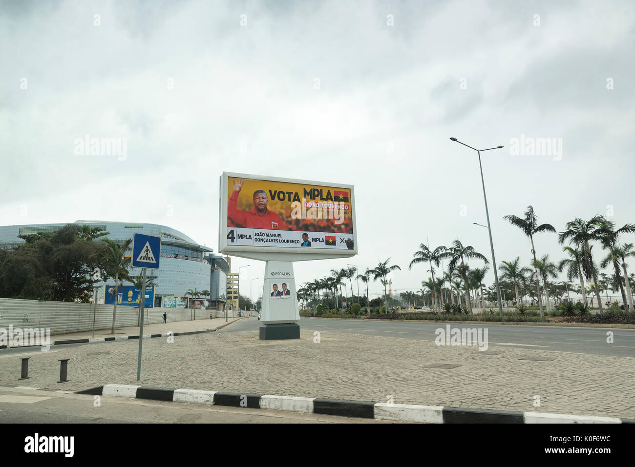 Luanda, Angola. 23rd August, 2017. A billboard advertises presidential canidate Joao Lourenco. Lourenco is from the ruling People's Movement for the Liberation of Angola (MPLA) party. Credit: Will Reynolds Photography/Alamy Live News - Stock Image