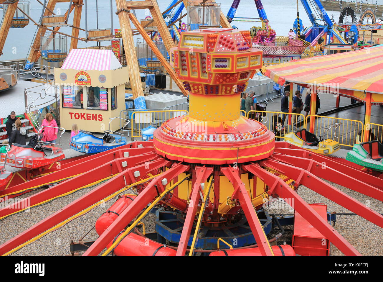seaside funfair with people - Stock Image