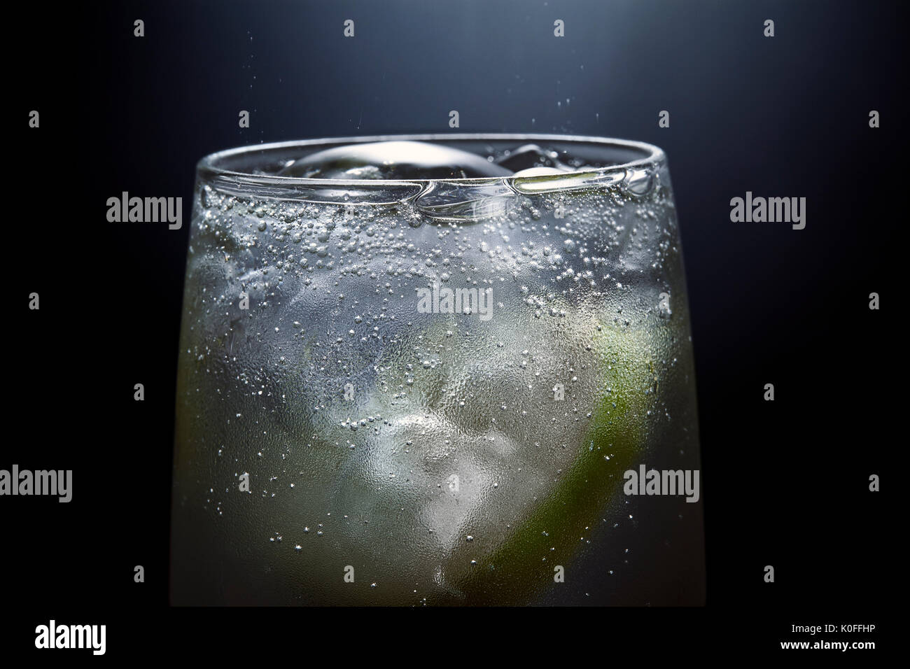 Fizzy Gin and Tonic drink with Lime - Stock Image