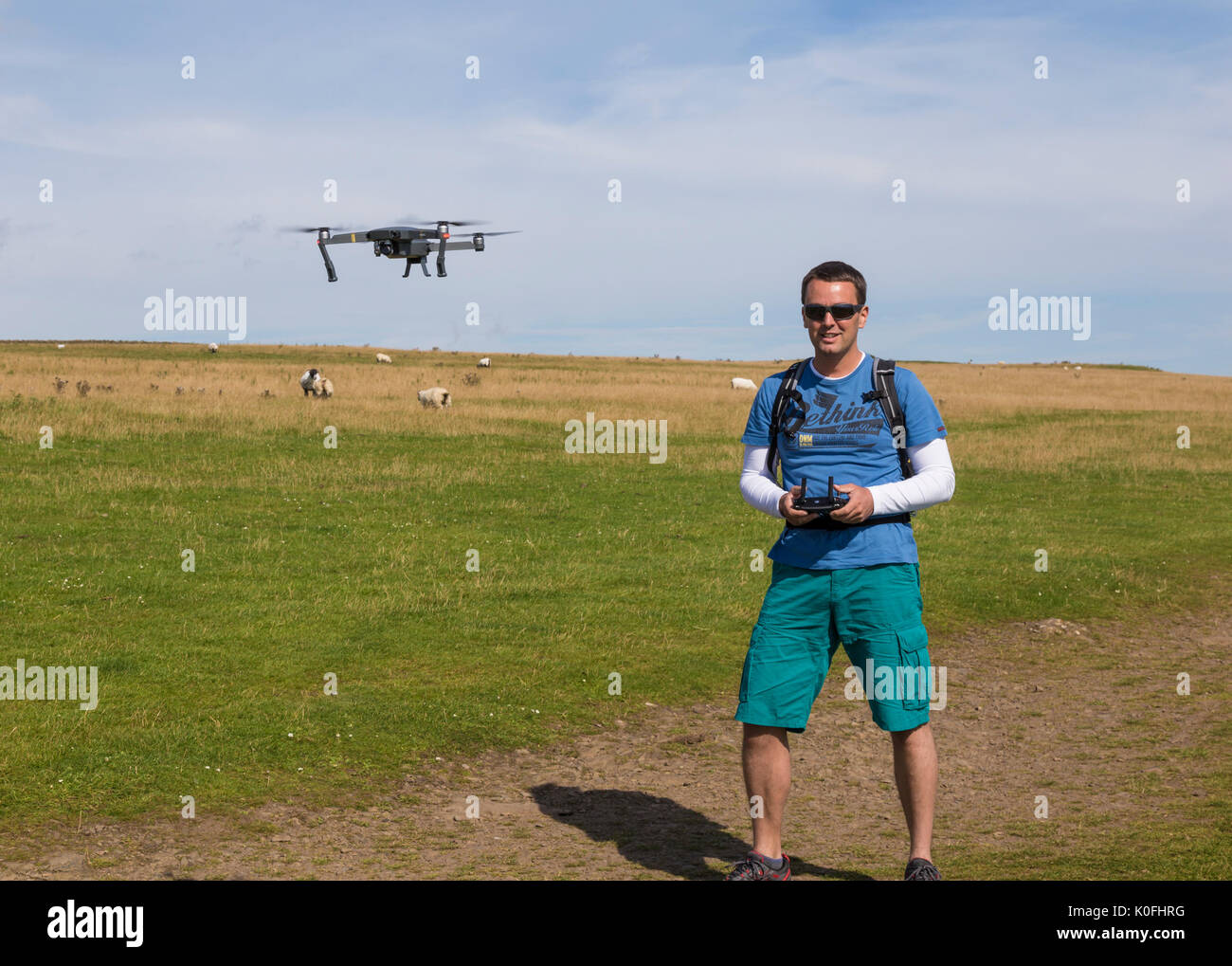 Man flying small drone - Stock Image