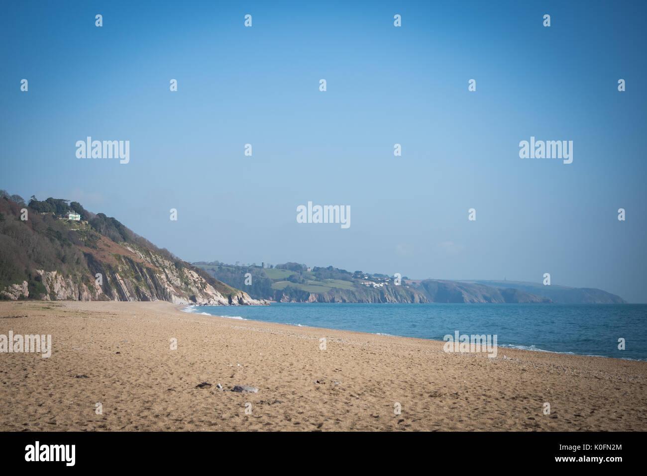Slapton sands on a cloudless summer sky. - Stock Image