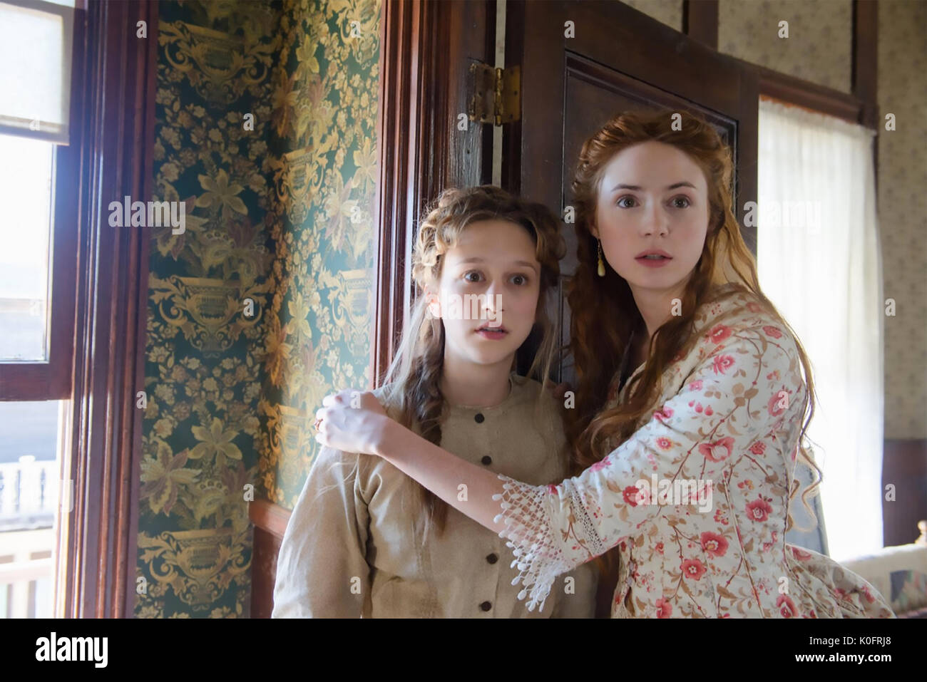 IN A VELLEY OF VIOLENCE  2016 Blumhouse Productions  film with Karen Gillan at right and Taissa Farmiga - Stock Image