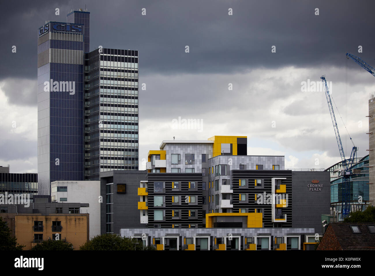 Manchester Northern Quarter modern yelow Smithfield apartments, Smithfield Square framed by the Coop CIS tower - Stock Image