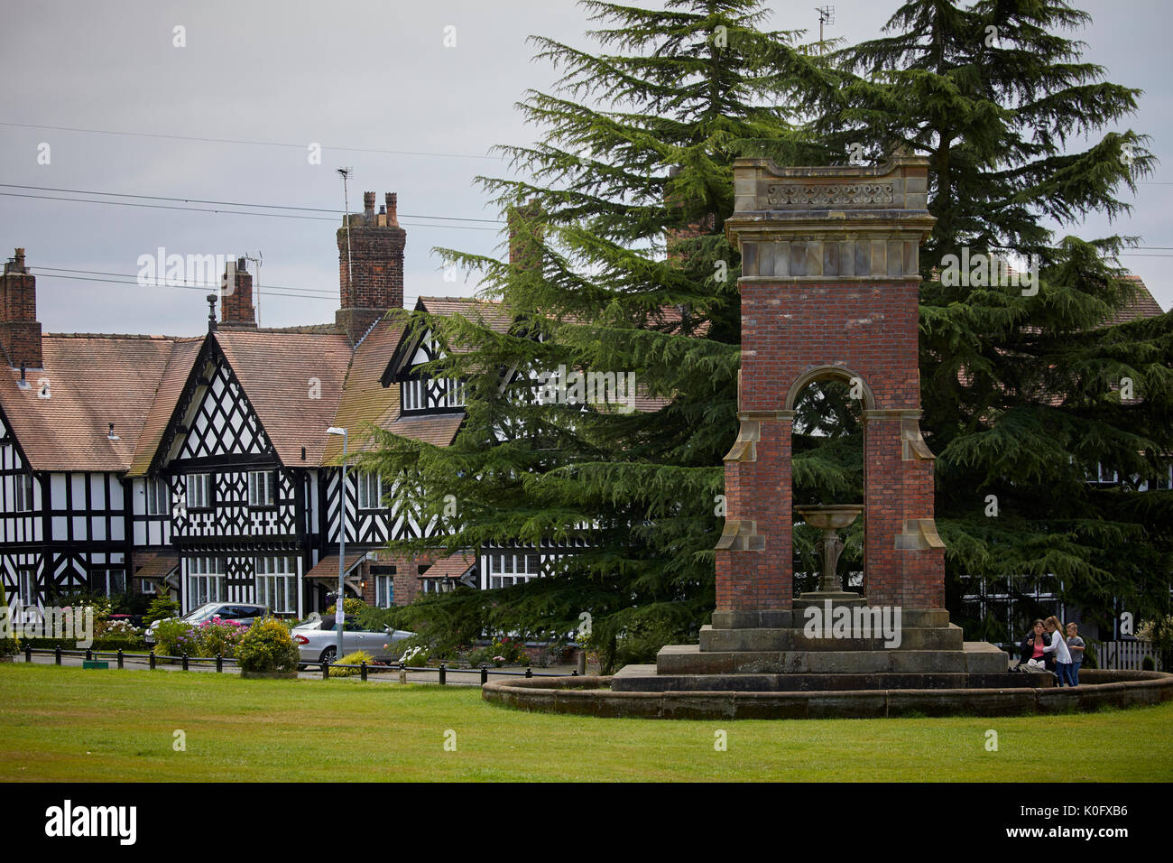Salford's picturesque Worsley green in Manchester formerly Worsley Yard and industrial area, tudor houses and  monument to Francis, 3rd Duke of Bridge - Stock Image