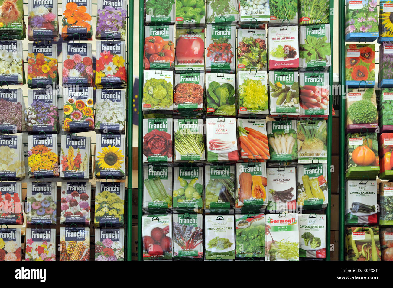 seeds in packets for sale on a stand colourful packets with different fruit flowers and vegetables for growing your own in the gardening hobby - Stock Image