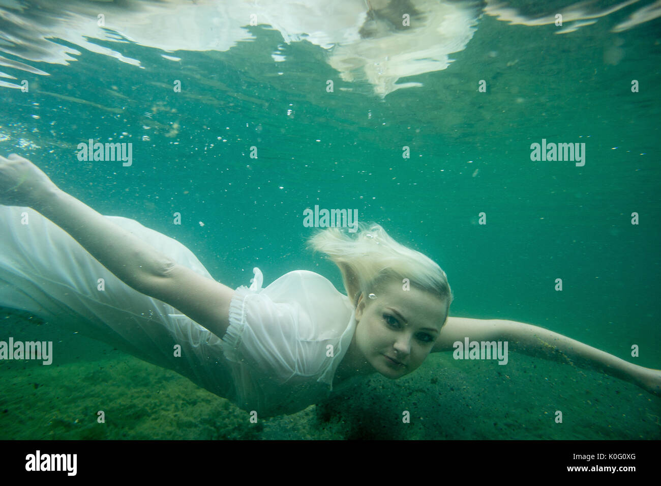 Mature women underwater