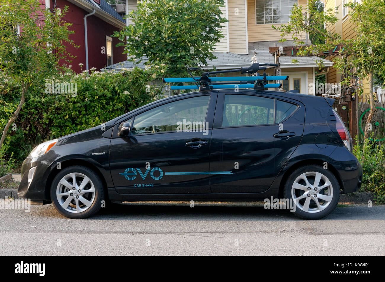 Toyota Prius c hybrid evo car share automobile parked on a residential street, Vancouver, BC. Canada - Stock Image