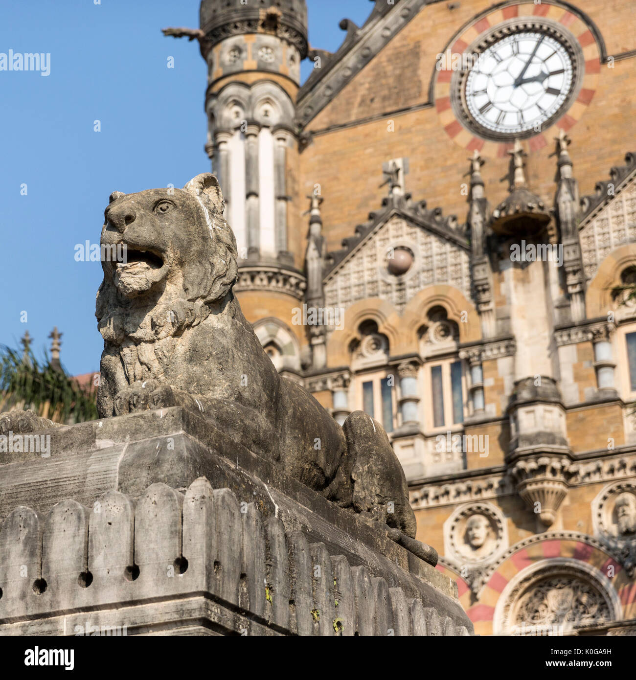 Clock Tower and Lion Statue at front of Chhatrapati Shivaji Terminus Railway Station, Mumbai - Stock Image
