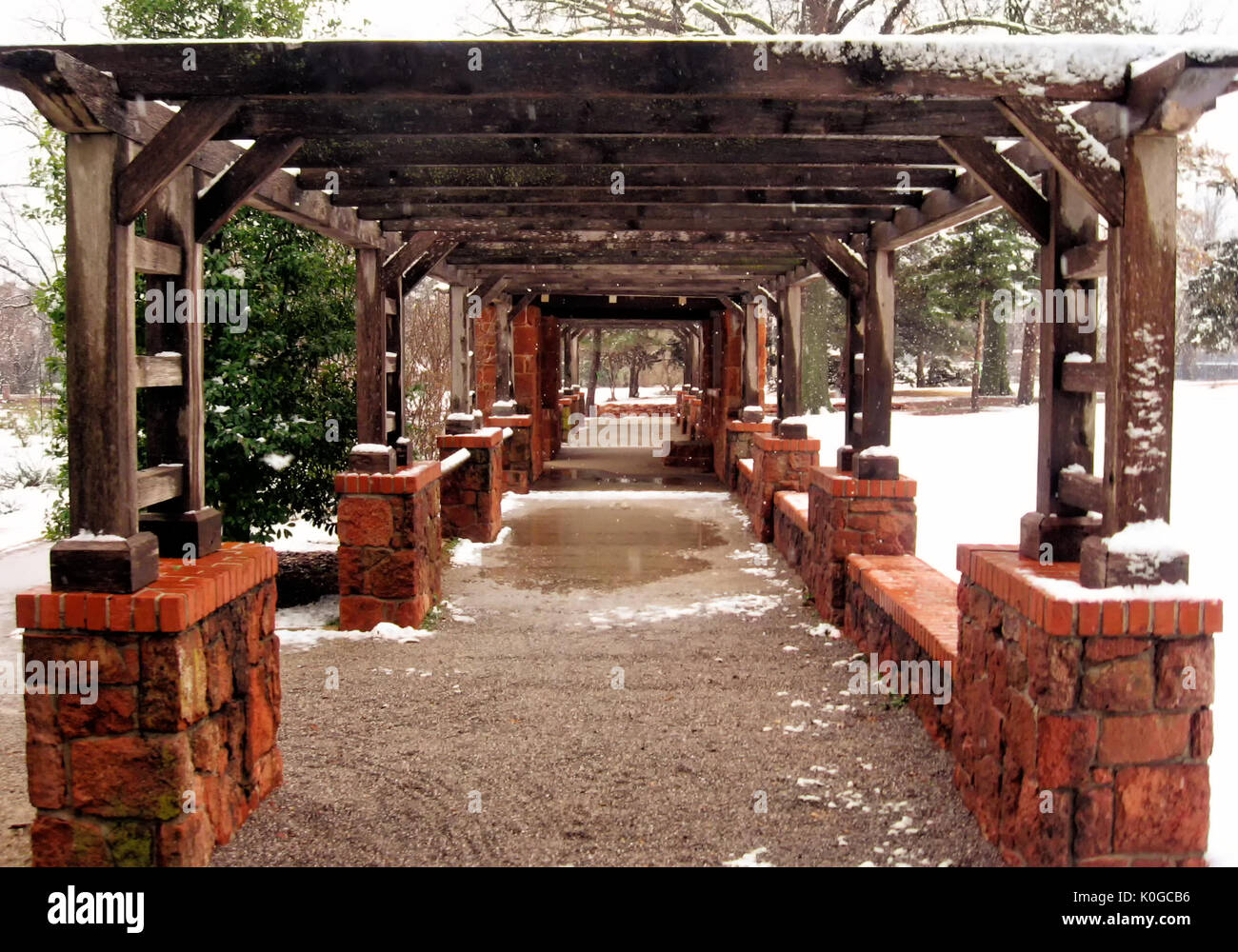 Rogers Garden Stone Will rogers garden stock photos will rogers garden stock images a wood and stone arbor trellis stands in the falling snow in oklahoma city workwithnaturefo