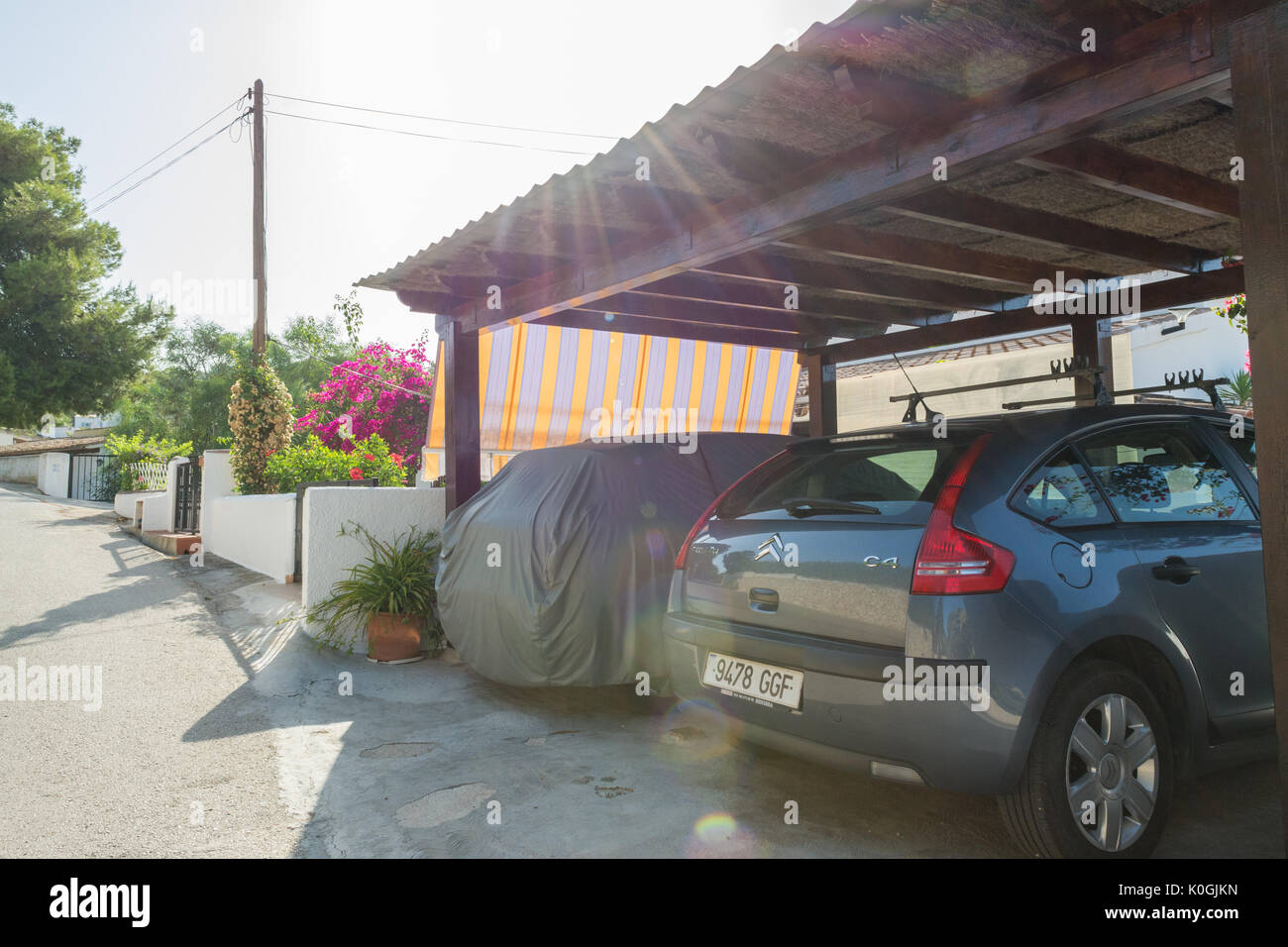 carport with sun shade protection in Spain - Stock Image