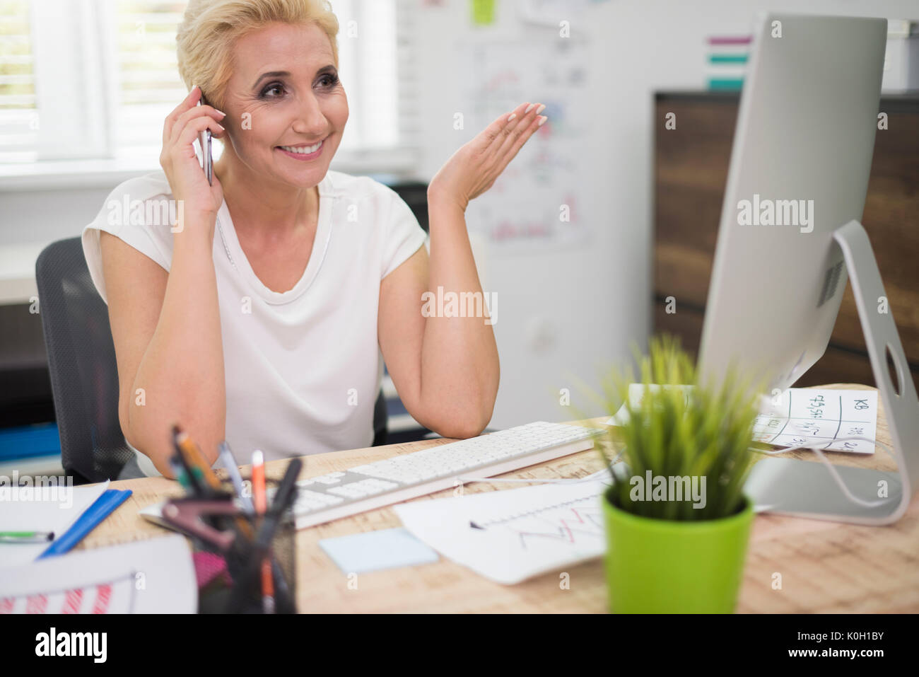 Executive of the company talking on the phone - Stock Image