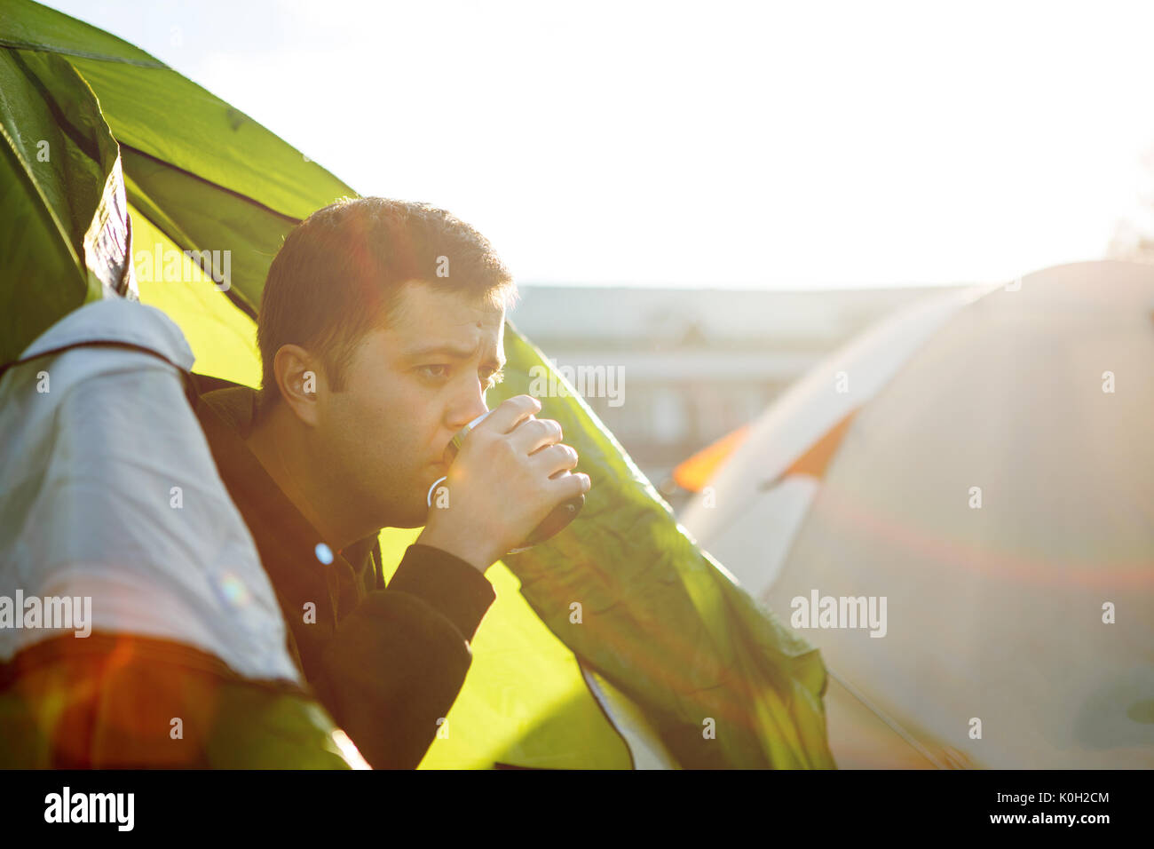 Photo of man in tent - Stock Image