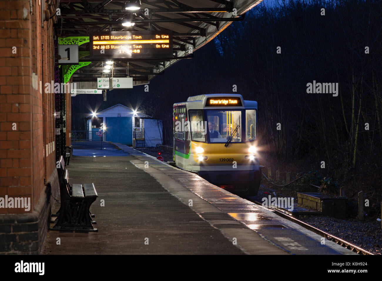 The 1755 Stourbridge Jn - Stourbridge Town awaits departure from Stourbridge Junction formed of a Parry people mover PPM 60 - Stock Image