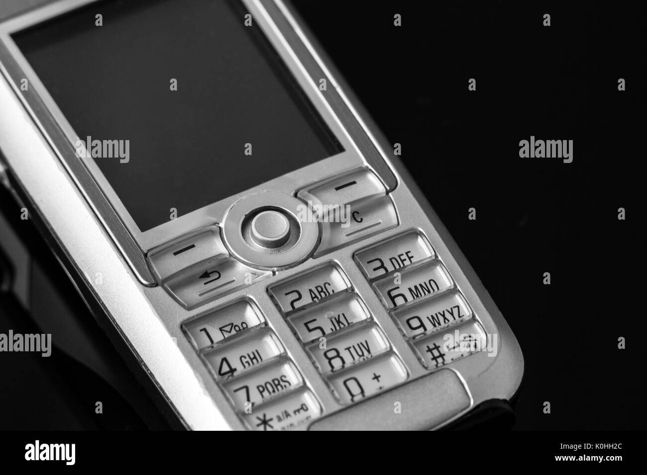 old numeric cell phone - Stock Image