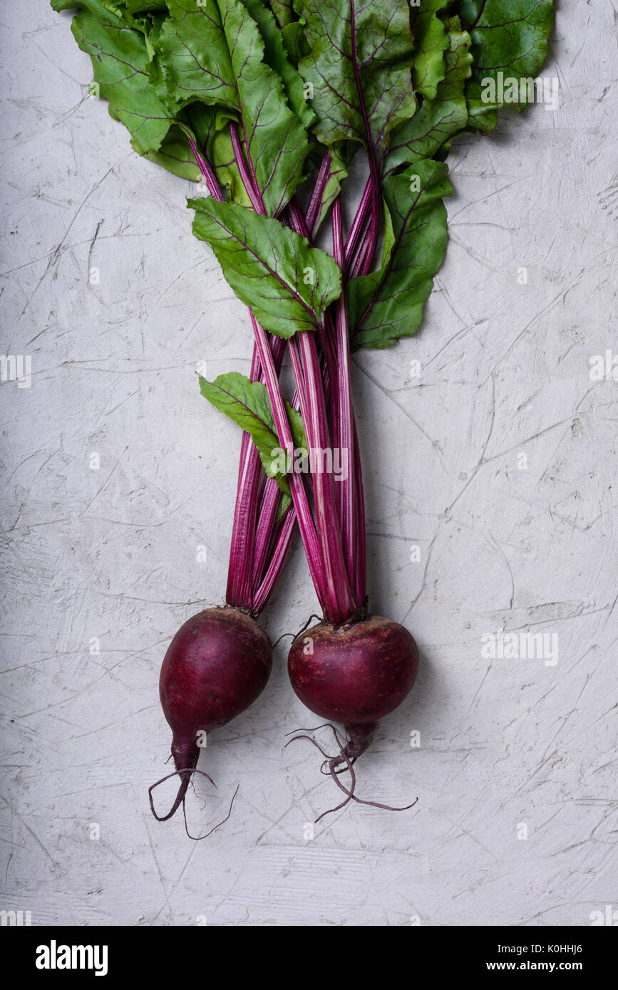 Fresh red beet with leaves. Autumn harvest, cooking ingredient. Above view. - Stock Image