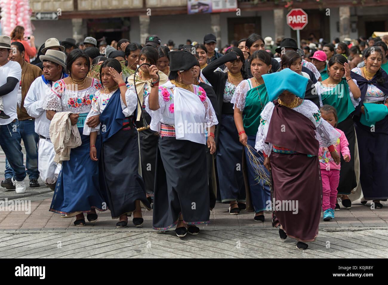 July 1, 2017 Cotacachi, Ecuador: indigenous Kichwa women marching on the street during Punchi Warmi celebration - Stock Image