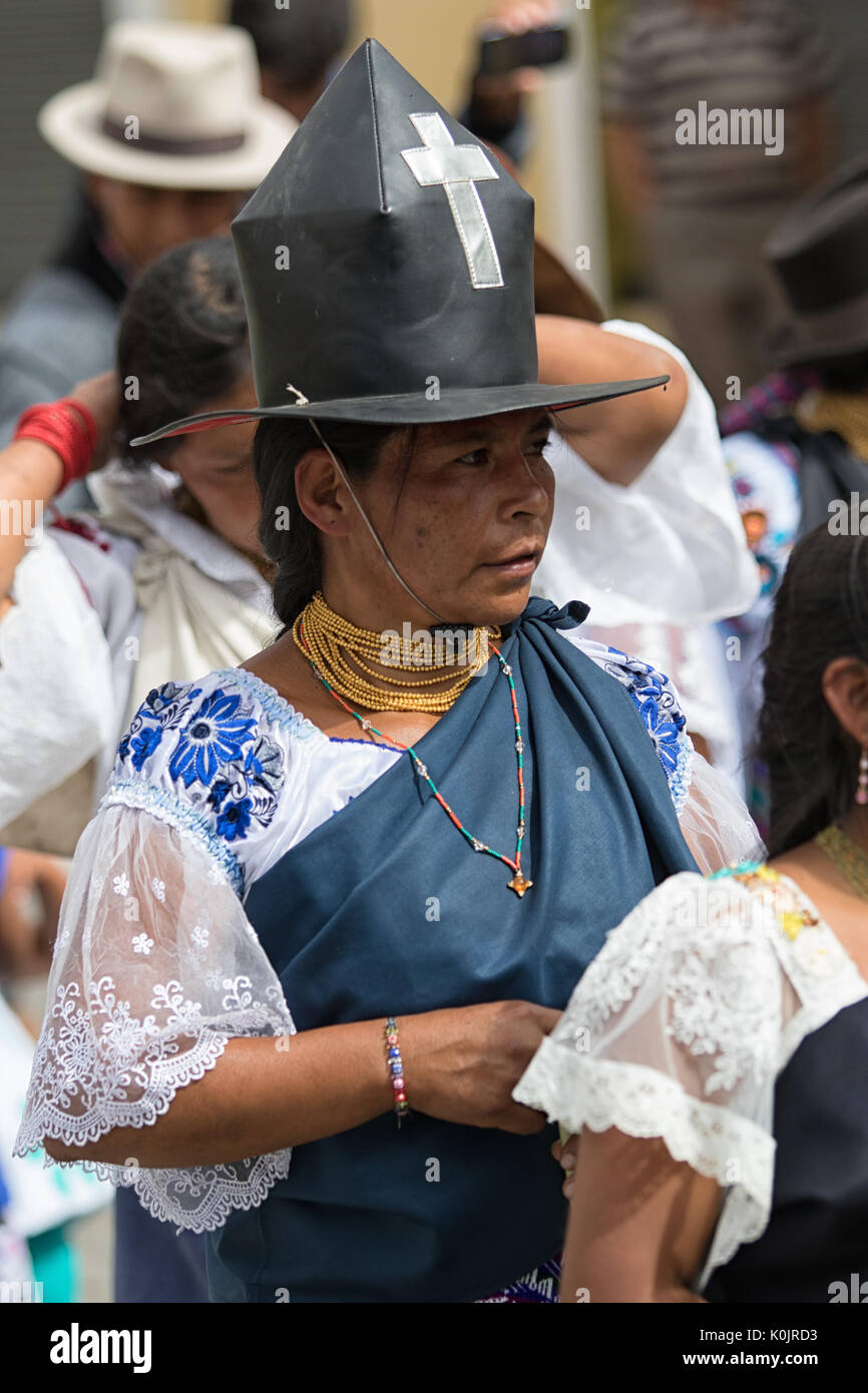July 1, 2017 Cotacachi, Ecuador: traditionally dressed Kichwa woman at Punchi Warmi celebration wearing a hat - Stock Image