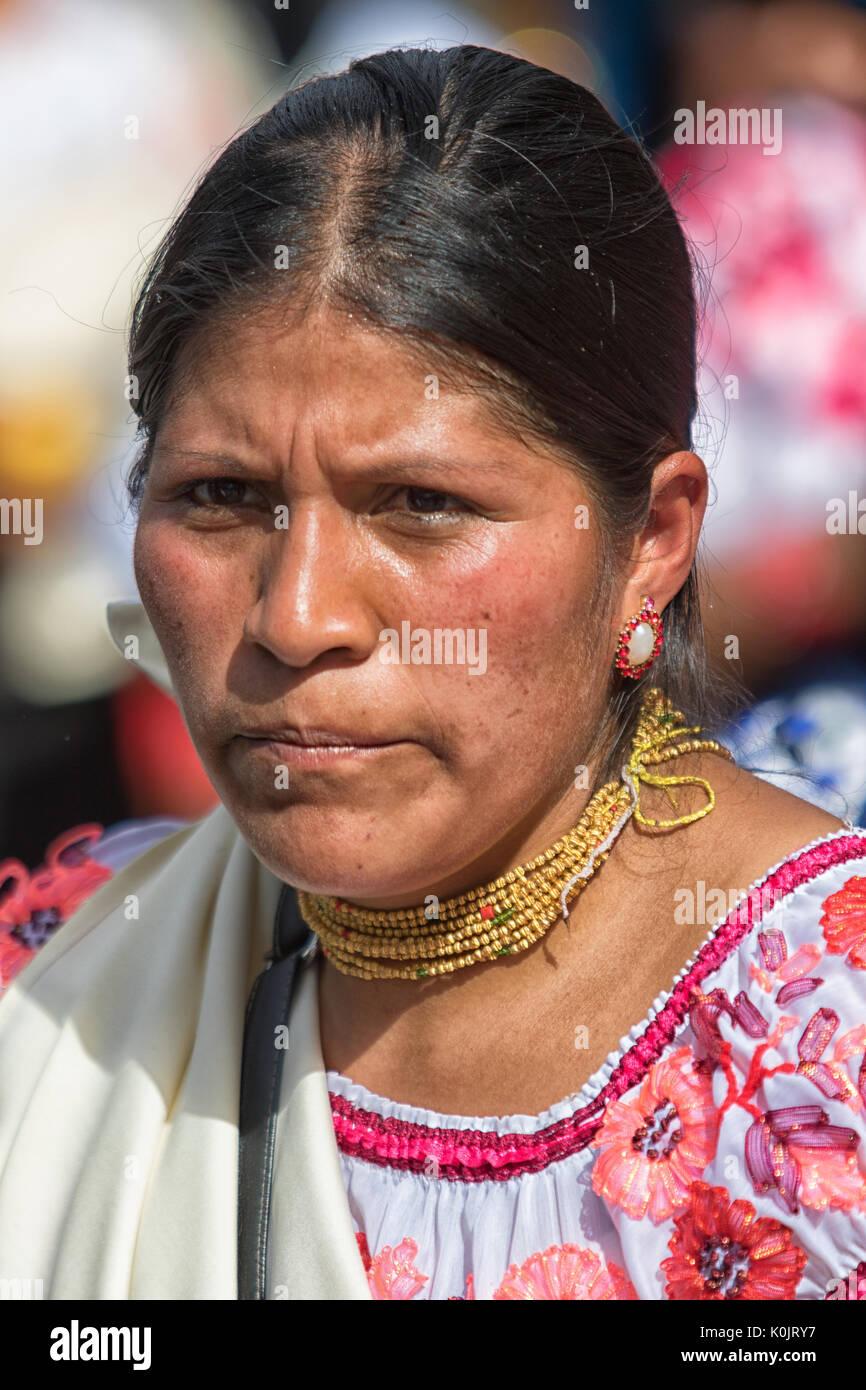 quechua woman in traditional wear in Cotacachi Ecuador during Punchi Warmi celebrations - Stock Image