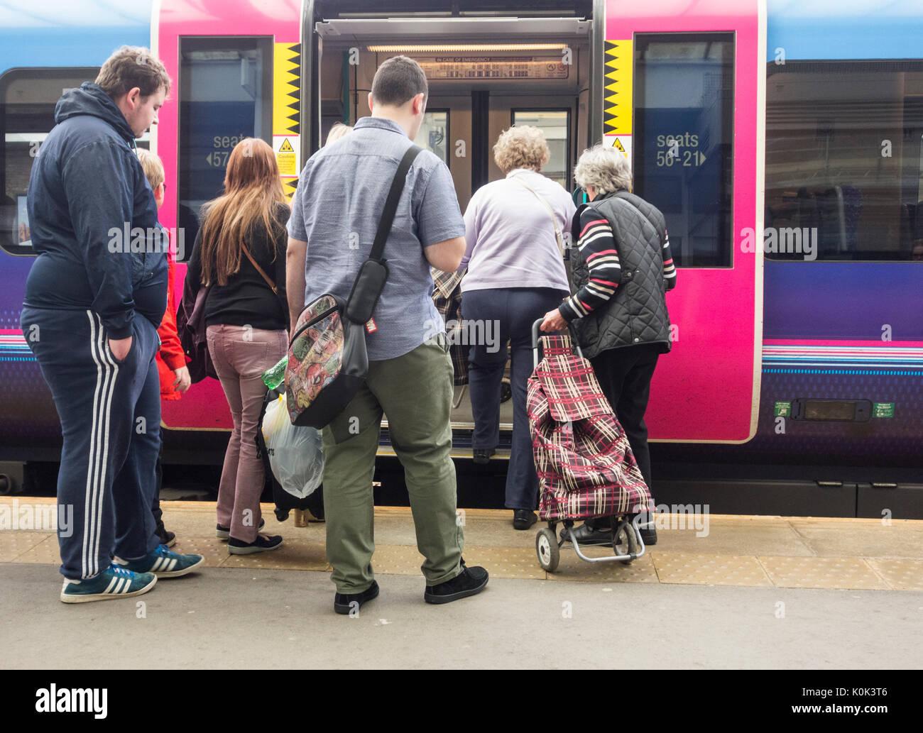 People boarding Transpennine express train at Middlesbrough station. UK - Stock Image