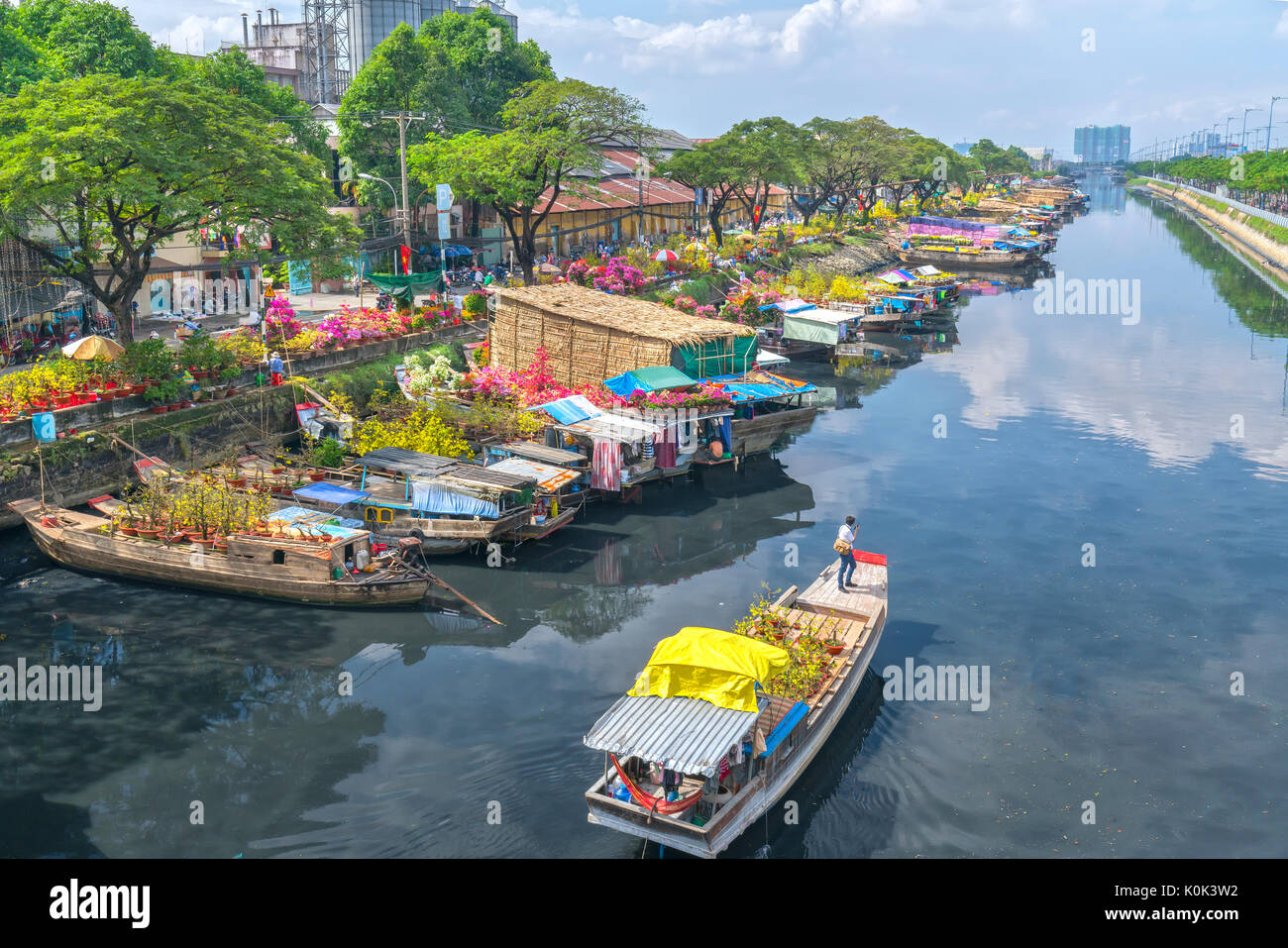 Binh Dong Floating Flower Market.Flowers Boats At Flower Market On Along Canal Wharf This Is Place