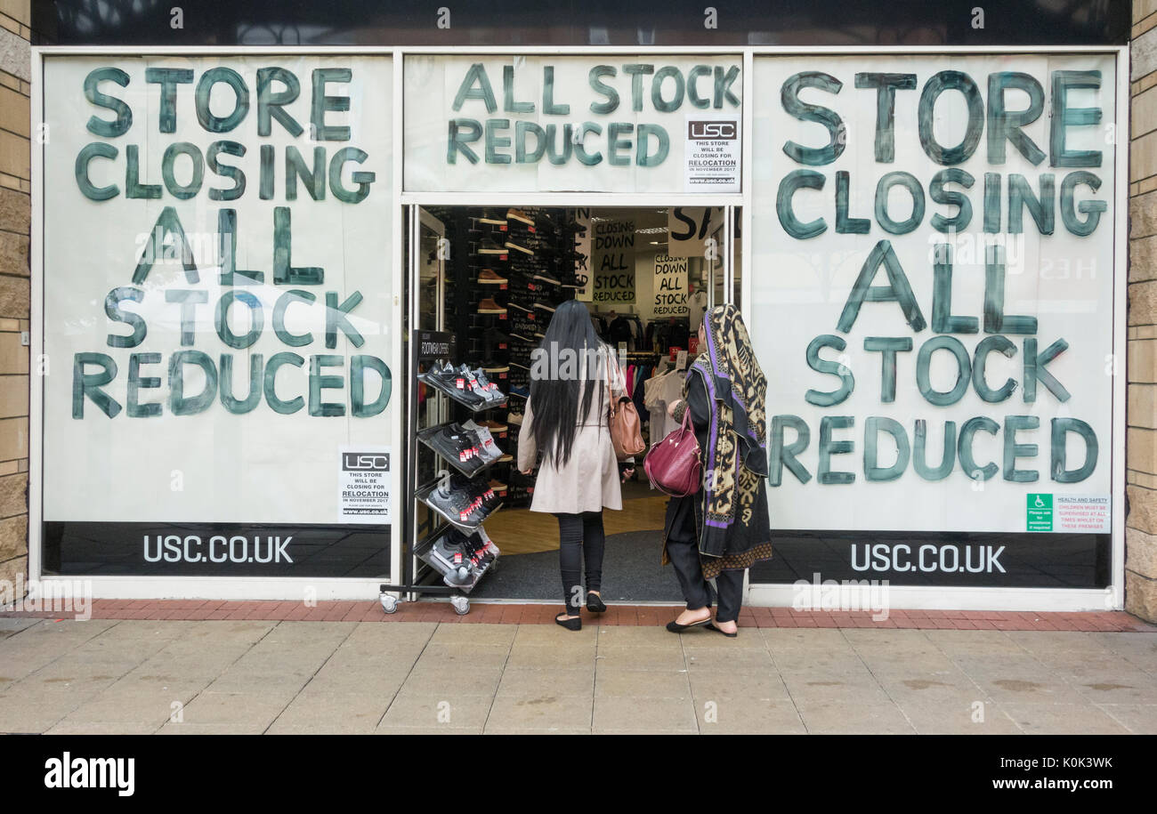 Store closing, all stock reduced... on USC store window in Middlesbrough, England. UK - Stock Image