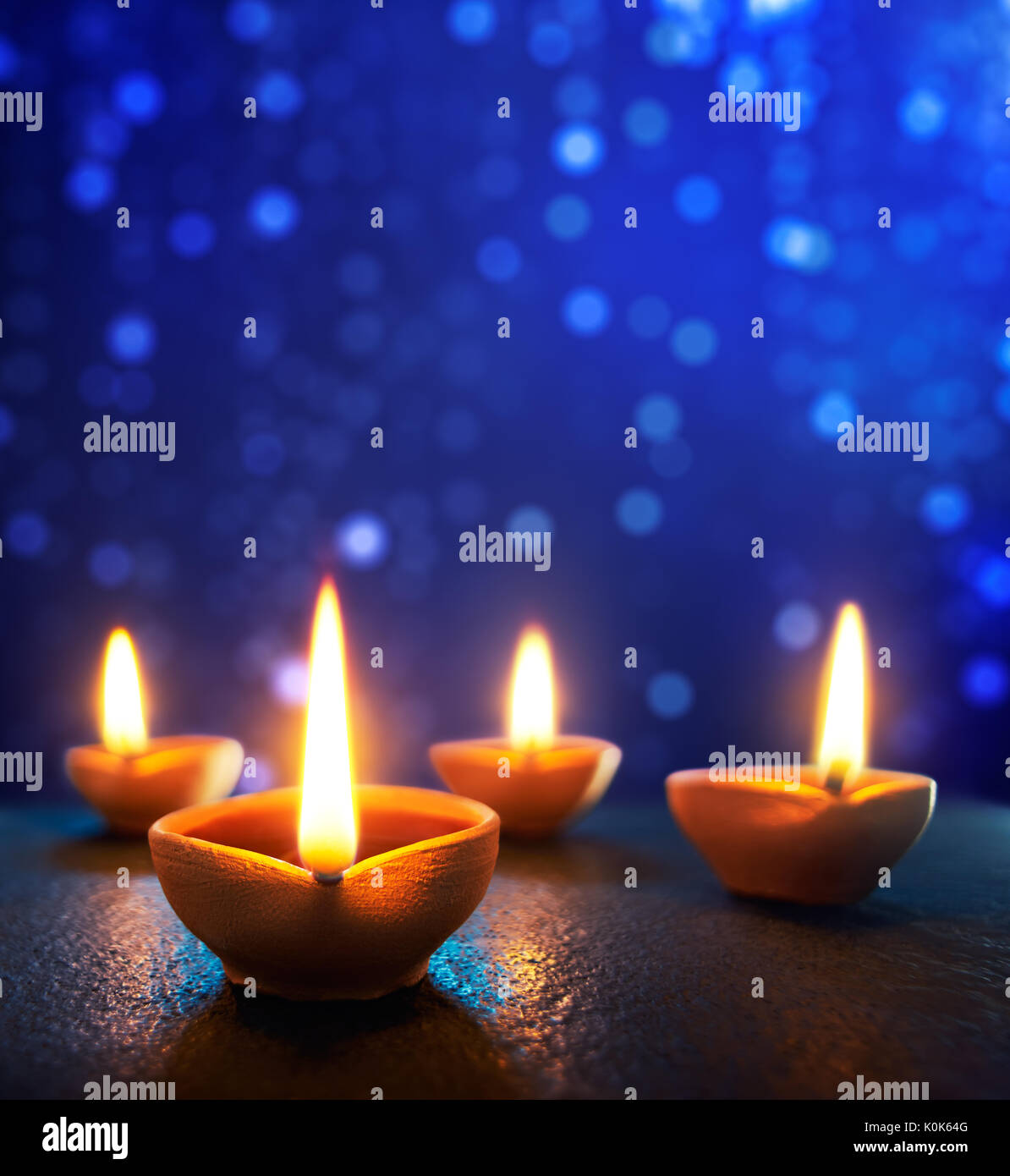 Happy Diwali - Diya lamps lit during Diwali celebration - Stock Image