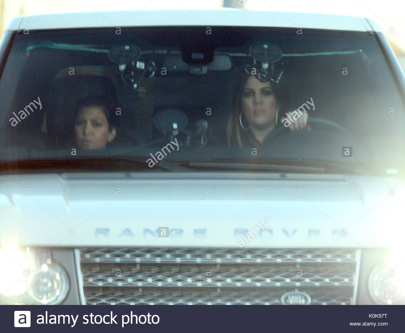 Khloe Kardashian and Kourtney Kardashian Khloe Kardashian shows off
