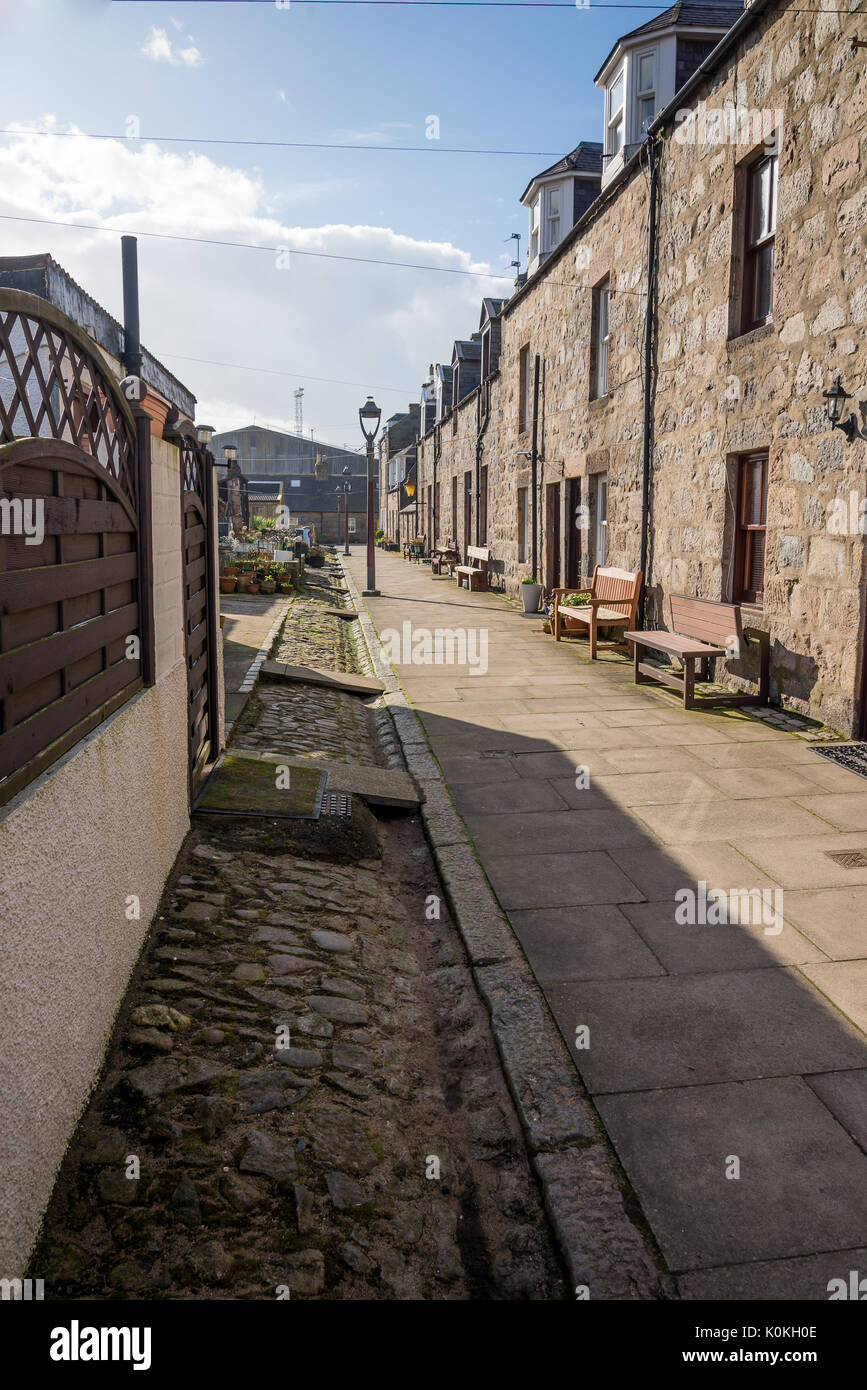 A quiet North Square walking street with two-storey granite houses next to the sea and beach in Aberdeen city,Scotland - Stock Image