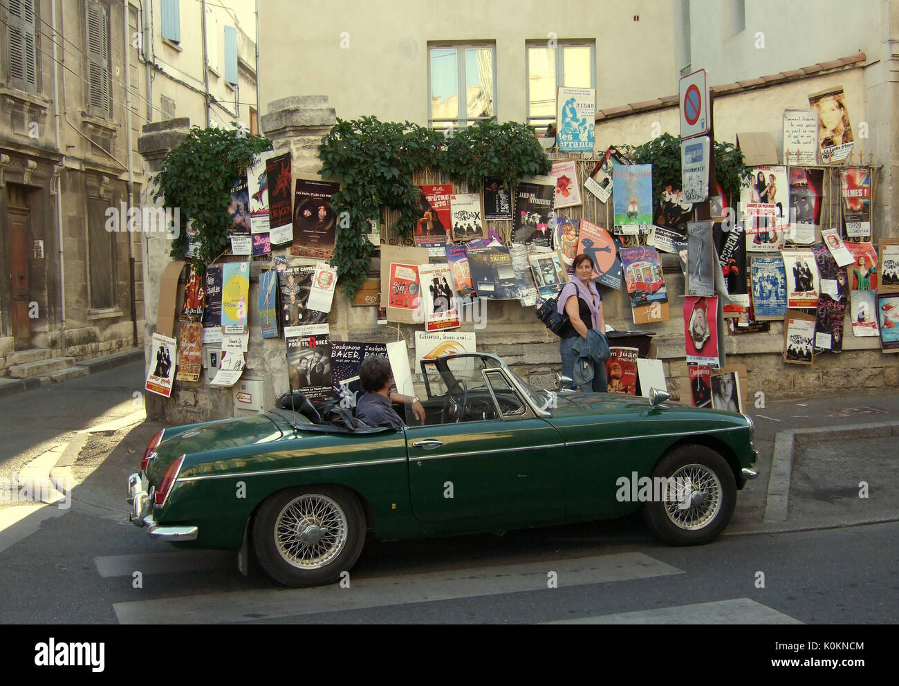 AVIGNON FRANCE - FESTIVAL D'AVIGNON - MG DRIVER LOOKING AT SHOW POSTERS ON A WALL © Frédéric BEAUMONT - Stock Image
