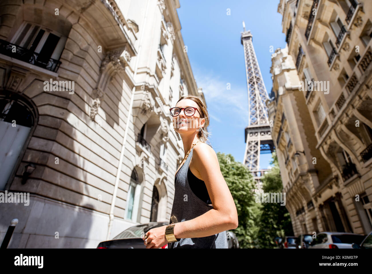 Woman walking in Paris - Stock Image