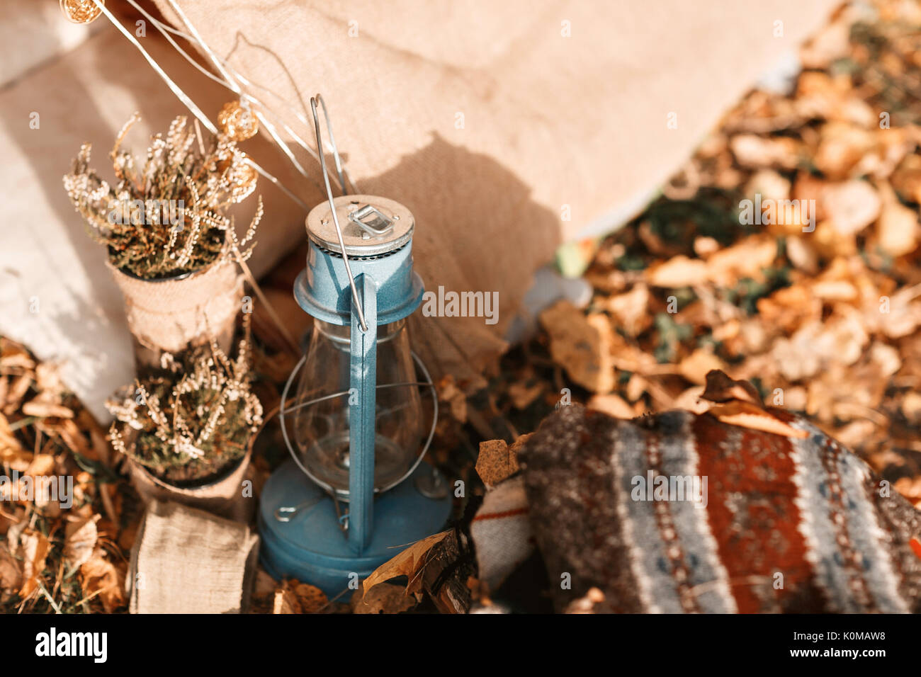 kerosene lamp. old tent in the autumn forest, home for adventure and travel - Stock Image
