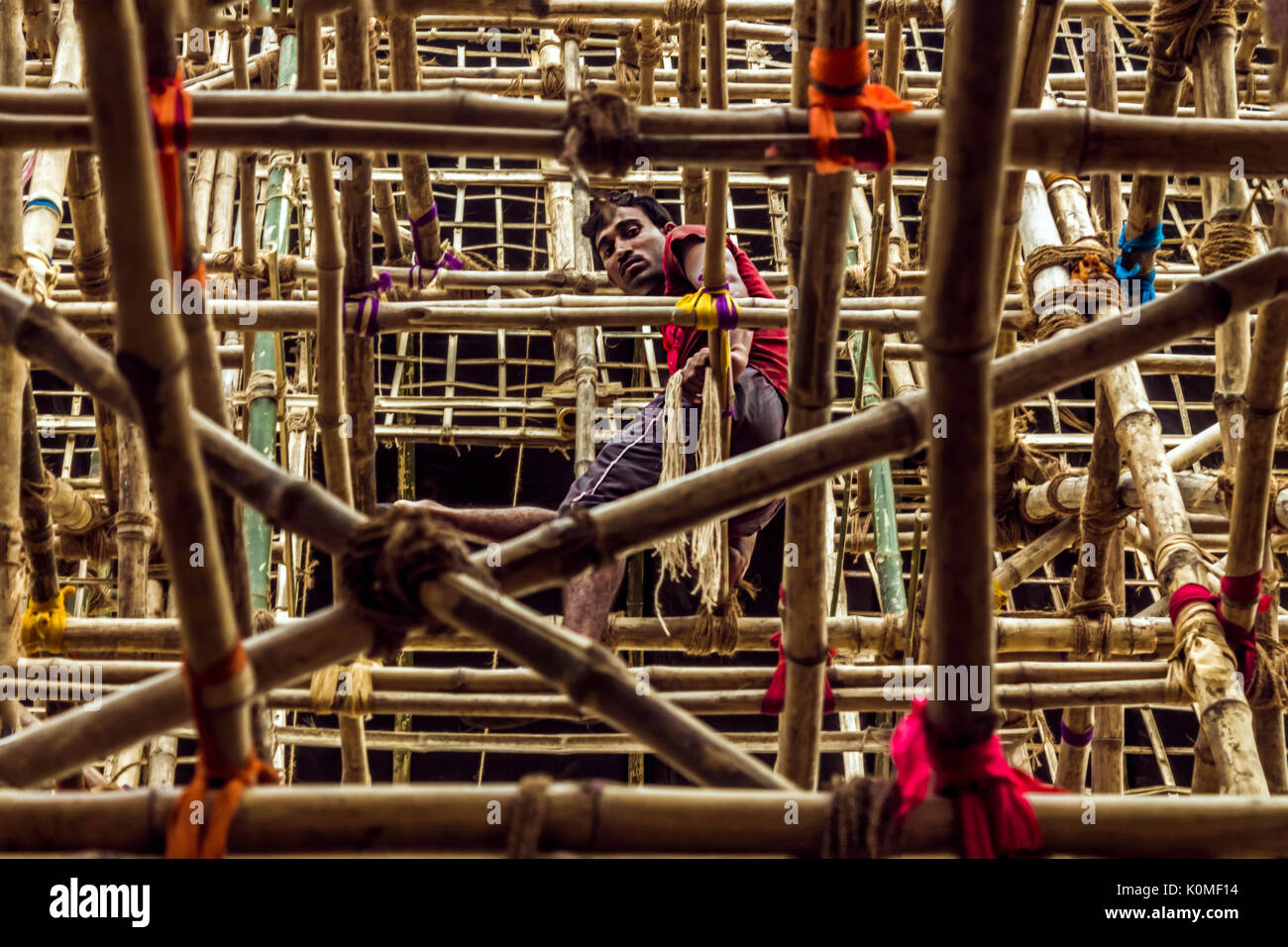 worker sitting on temporary pandal, durga festival, kolkata, west Bengal, India, Asia - Stock Image