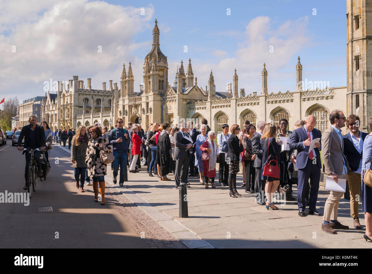 Cambridge graduation UK, relatives and friends of Cambridge University undergraduates queue in King's Parade to attend a graduation ceremony, England. - Stock Image