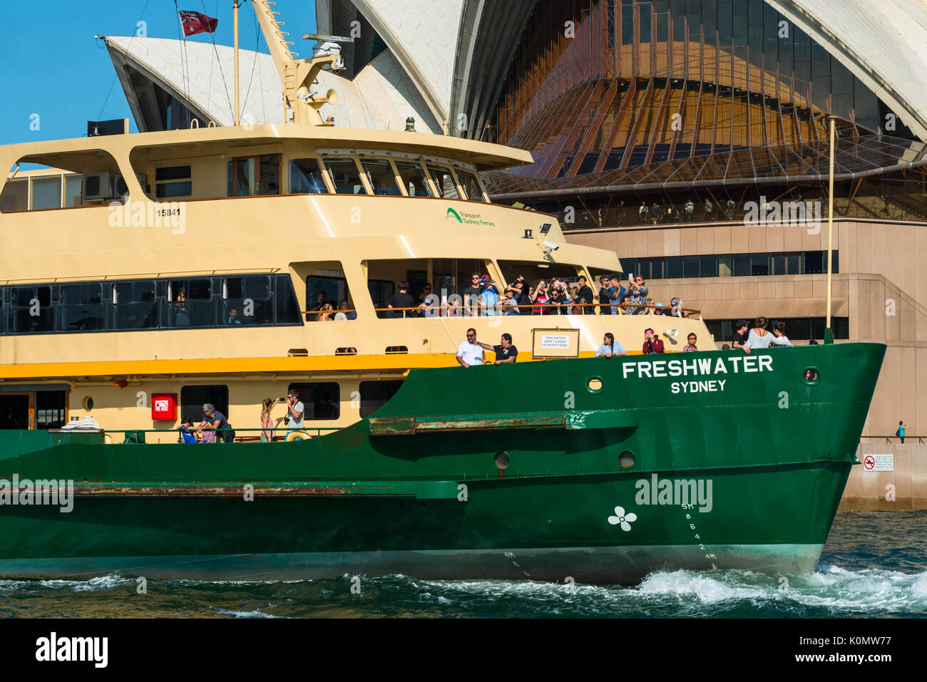 Closeup of Manley Ferry passing near to Sydney Opera house, Sydney, New South Wales, Australia - Stock Image