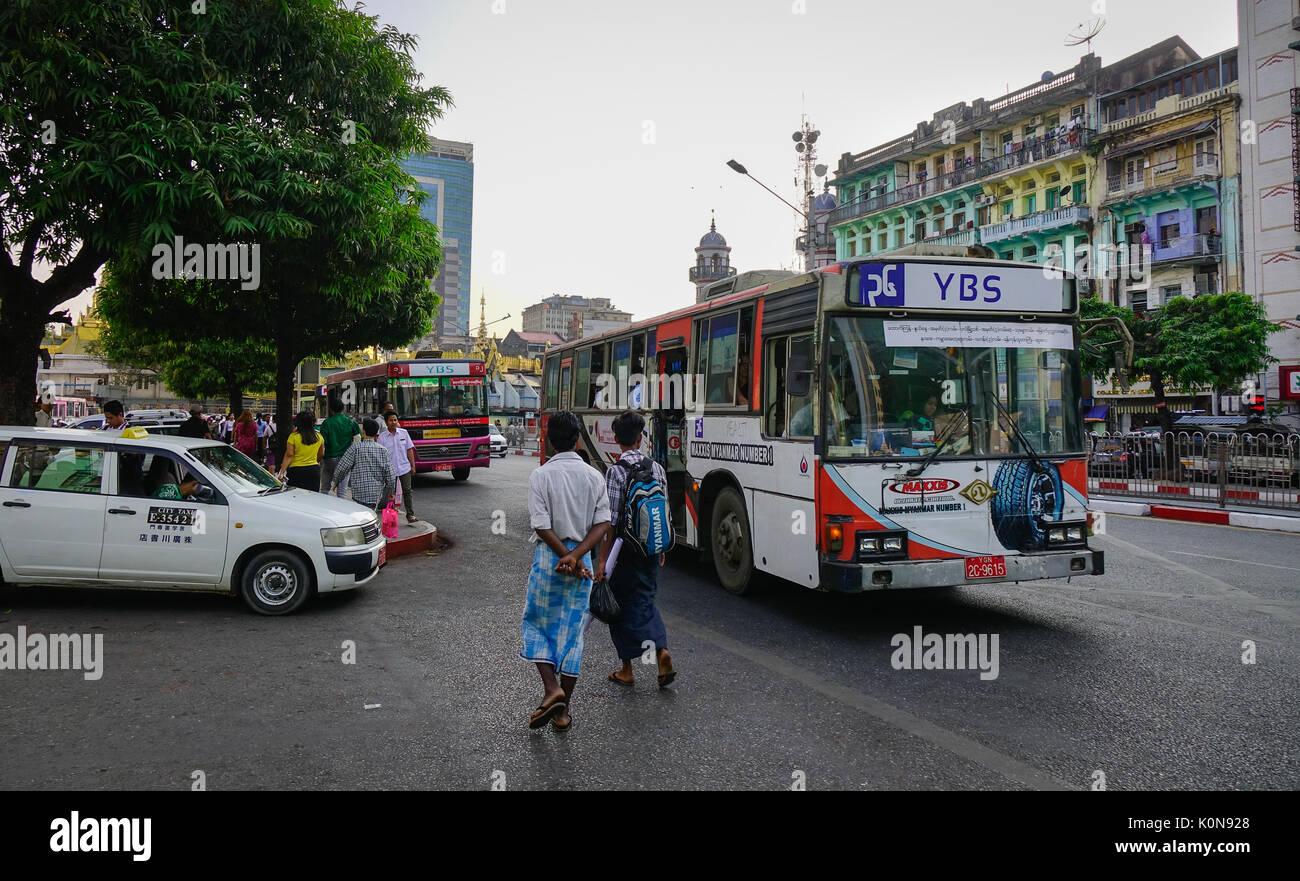 Yangon, Myanmar - Feb 13, 2017. People and vehicles on street in Yangon, Myanmar. Yangon is the country main centre Stock Photo