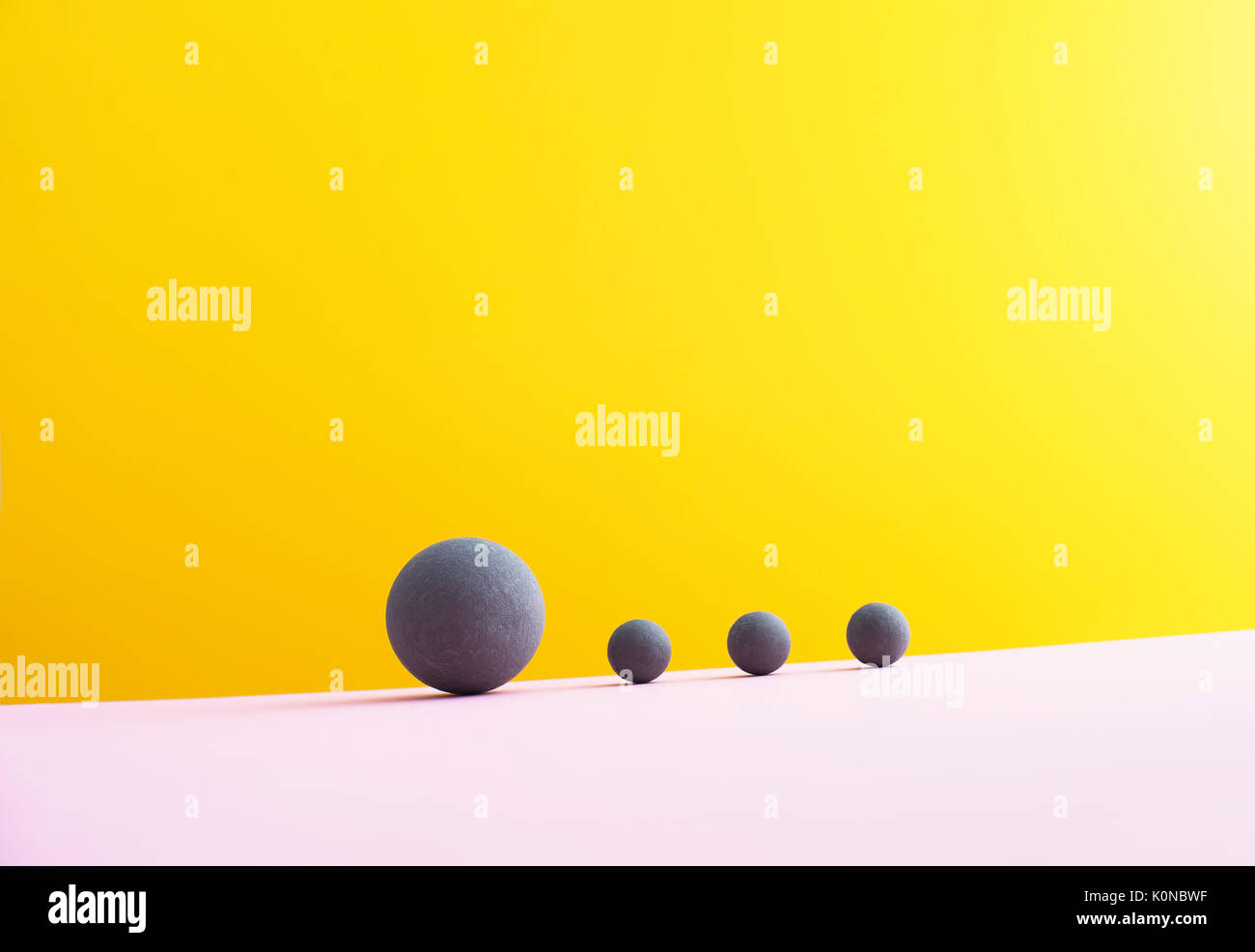 Four spheres against yellow background, 3D Rendering - Stock Image